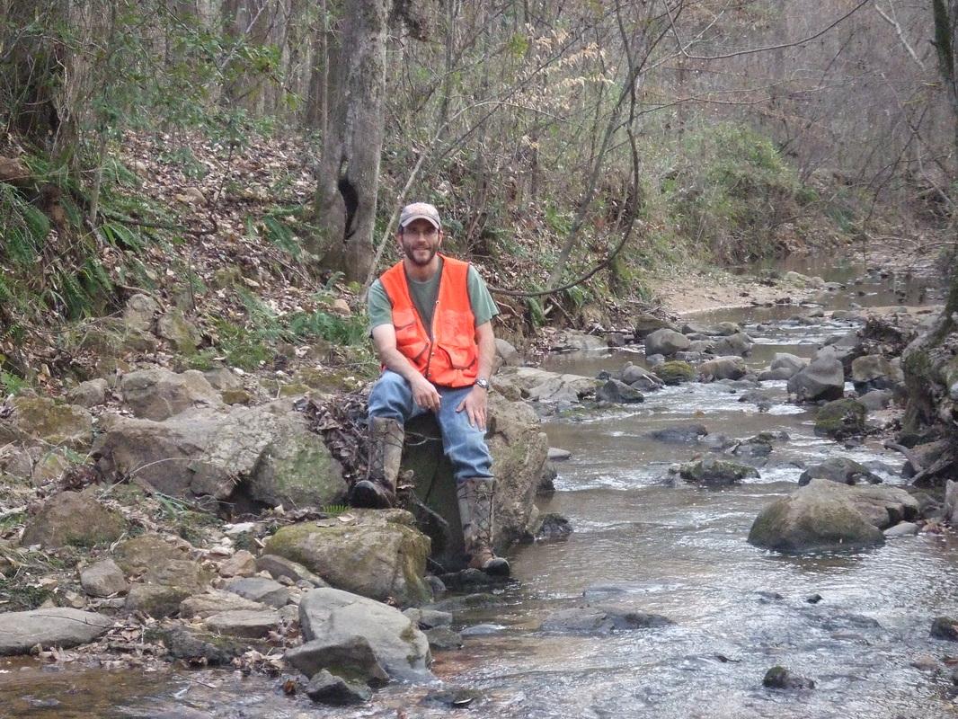 Dr. Matthew Ricker in the field of a NC piedmont stream
